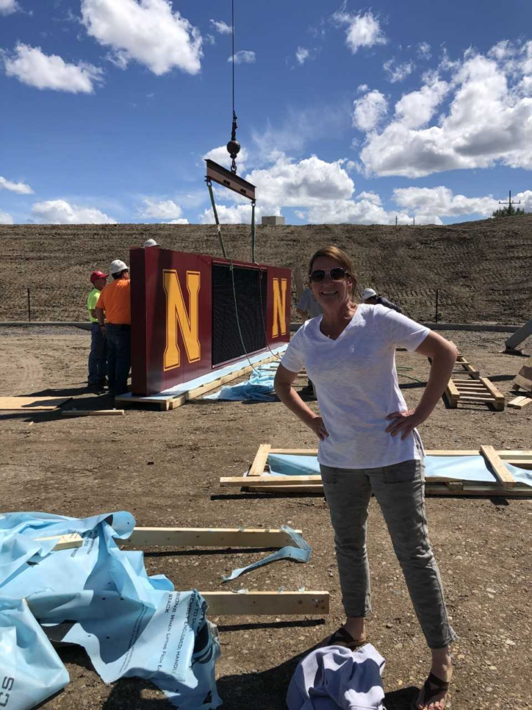 Shantel Cronk, CEO of the Foundation, went to watch the installation of the scoreboard in June