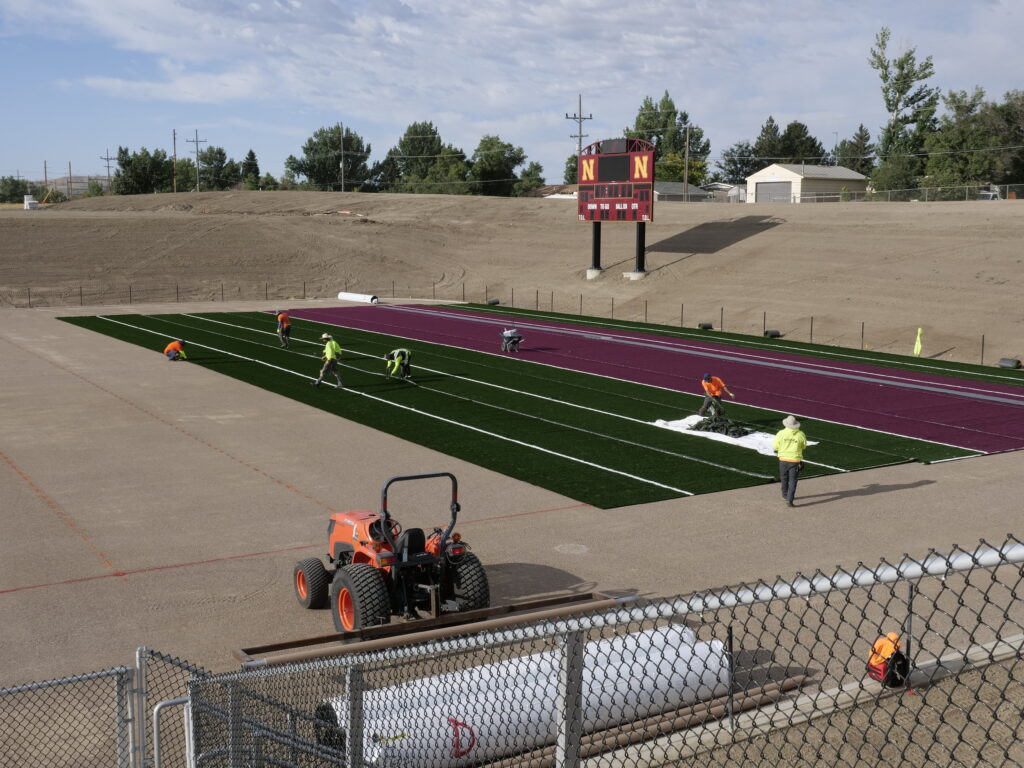 Rolling out the turf, August 2020